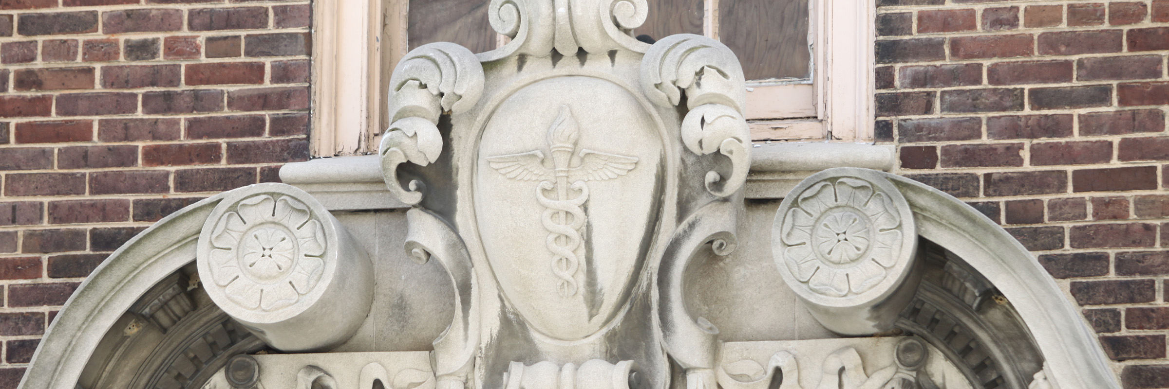 Closeup of the caduceus above the doorway of the Health Sciences Library on the MCV campus.